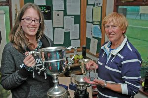 Claire Wiley receives the women's singles cup from Ann Walling